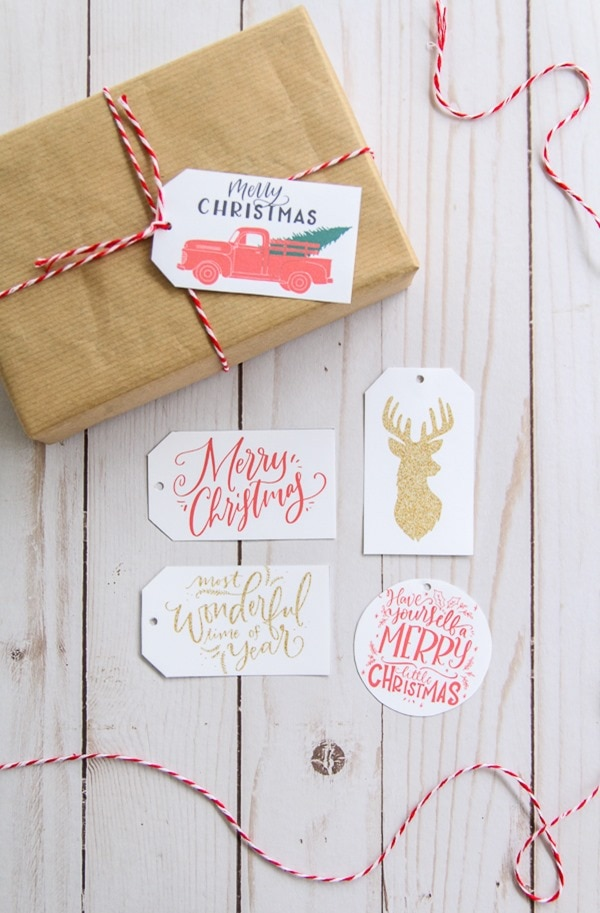 free printable gift tags with a present wrapped in brown paper.
