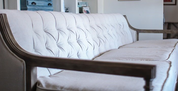 front view of diamond tufted couch back