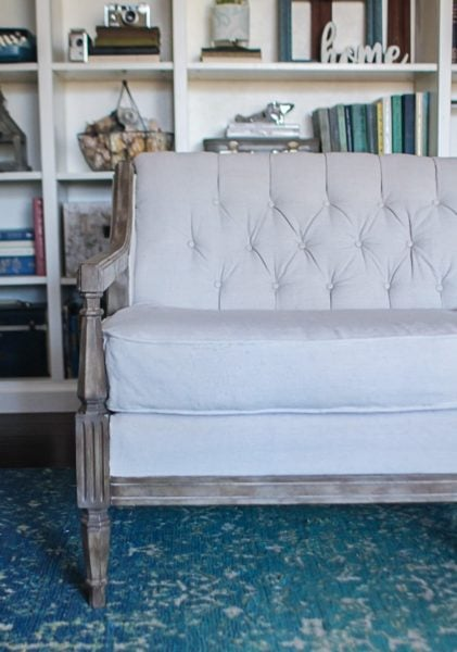 Vintage sofa with a tufted back reupholstered using drop cloth.