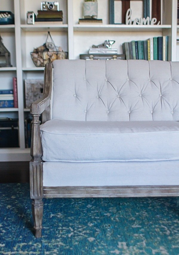close up of reupholstered couch with tufted back