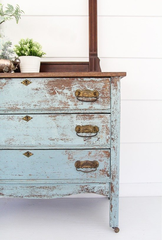 Blue chippy farmhouse dresser painted with old-fashioned milk paint.