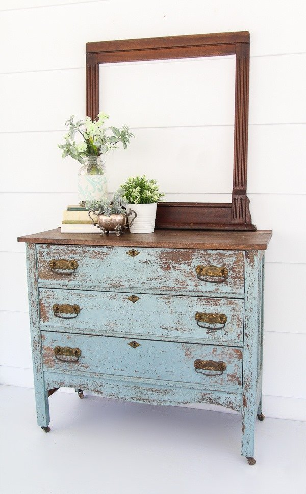 Blue farmhouse dresser makeover. This chippy paint looks so authentic and is easy to diy with milk paint.