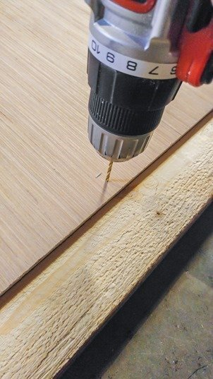 drilling holes for screws to attach frame