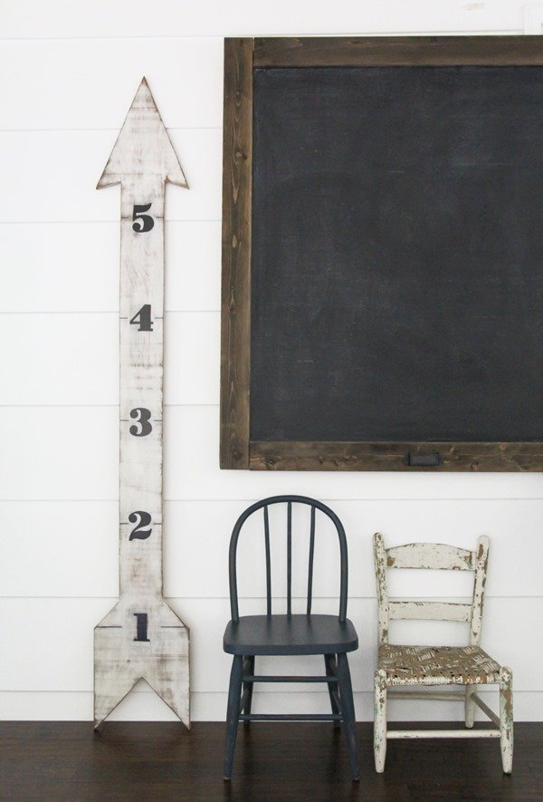 How to make a large DIY chalkboard. It is super easy and cheap to make this huge chalkboard and the rustic details add the perfect amount of vintage style for any space.