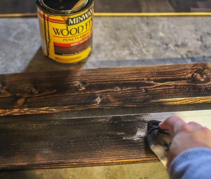 staining the rustic frame