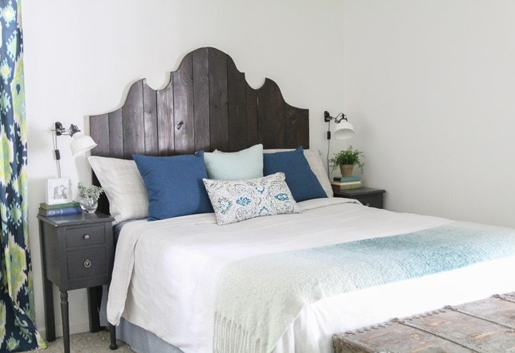 bedroom with diy curvy wooden headboard
