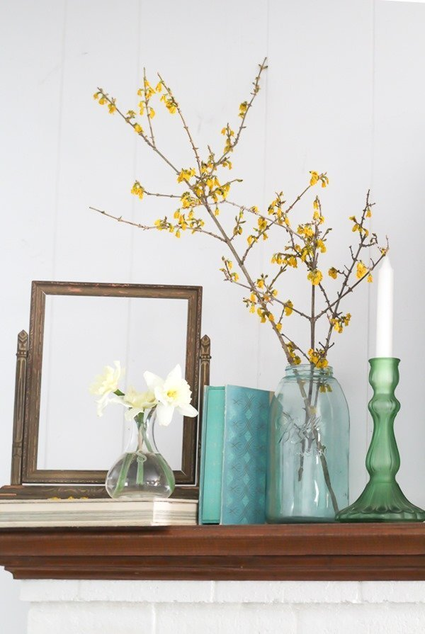 Decorating with nature on a spring mantel