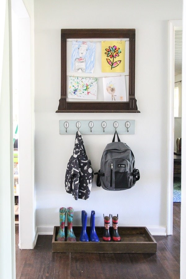 Create a mini mudroom in a tiny space with a backpack station, shoe storage, and a spot to display kids artwork.
