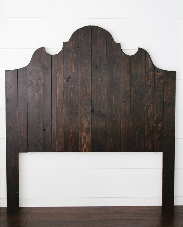 Learn how to make an easy DIY wooden headboard using inexpensive wood planks.