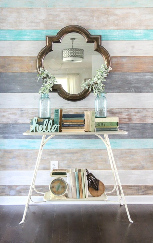 Turn a basic, small entryway into a beautiful, functional space with an easy wood plank wall, a pretty mirror, and a mini command center.