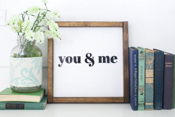 diy wood sign that says you and me with a white background and wood frame