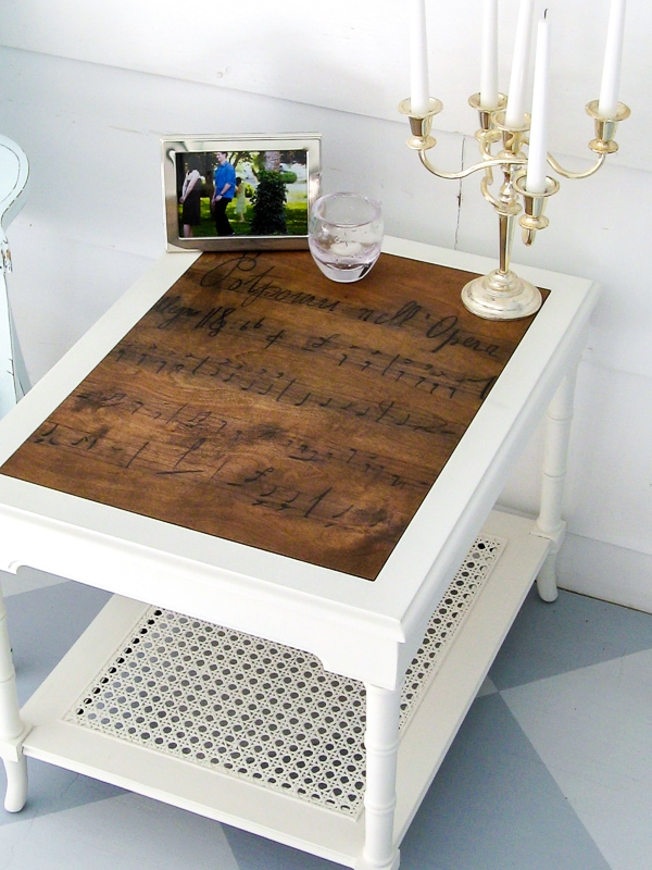 End table with a plywood top with a sheet music design transferred onto it.