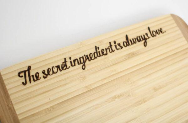 Cutting board with custom DIY wood burned phrase.
