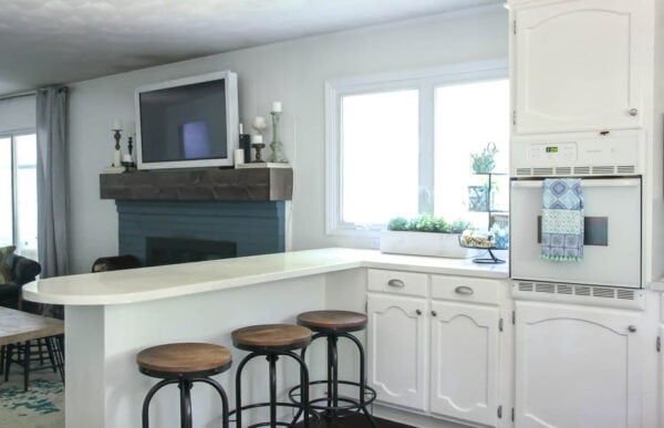 Blue and white modern farmhouse kitchen and family room on a budget.