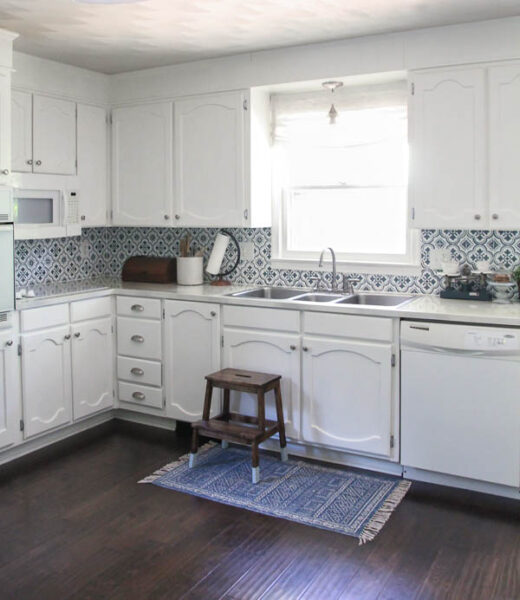 How to completely transform your dated kitchen on a budget with paint - painted cabinets, painted countertops, painted backsplash.