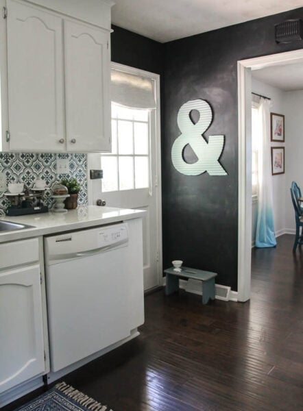 Blue and white modern farmhouse kitchen makeover on a budget.  Love the chalkboard wall in the corner.
