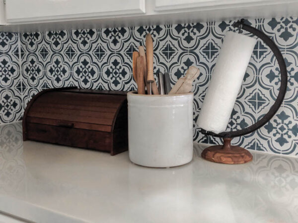 Add warmth and character to a white modern farmhouse kitchen with warm wood tones and vintage finds.