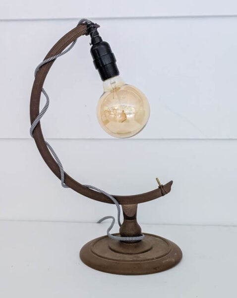 This beautiful diy lamp is repurposed from an old globe stand. Such a unique upcycled lamp idea.