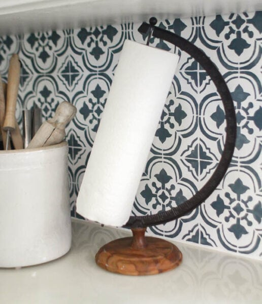 Paper towel holder upcycled from an old globe stand