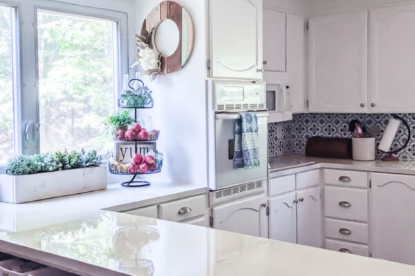 kitchen with white painted cabinets and painted countertops.
