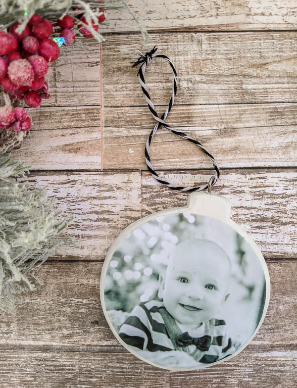 These DIY personalized Christmas ornaments are quick and easy to make. With a photo on one side and a name on the other, these diy photo ornaments are perfect for celebrating a baby's first Christmas, a first married Christmas, or any other major milestone.
