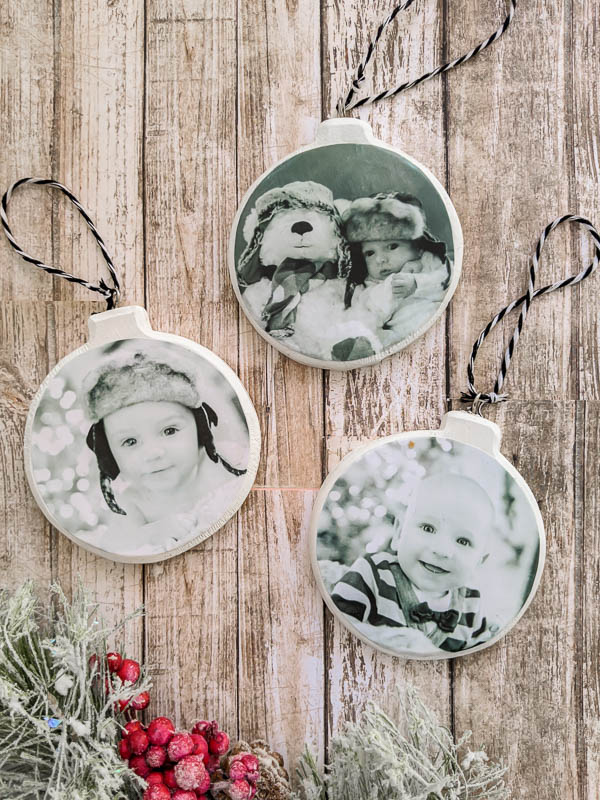 Easy DIY photo Christmas ornaments that only take minutes to make. These personalized ornaments are perfect for your own tree or they are a great inexpensive gift idea.