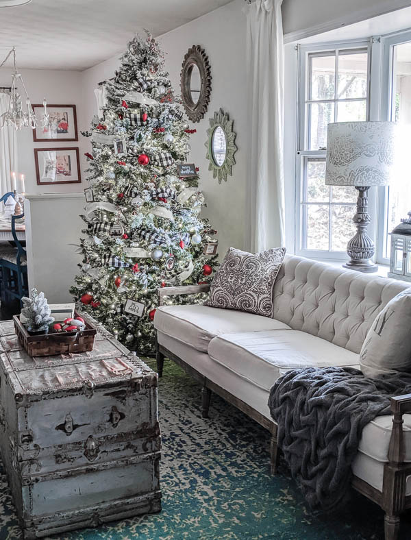 This classic red and white farmhouse Christmas tree adds just the right amount of cheer to any space without overpowering the room. Decorated with lots of simple farmhouse ornaments and buffalo plaid ribbon.