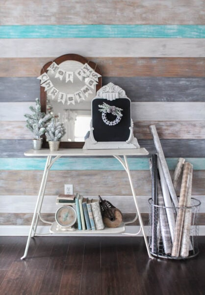 Neutral Christmas decor adds the right festive touch to this wood plank wall. This home is full of inexpensive Christmas decorating ideas and DIY Christmas projects.