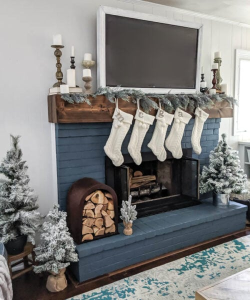 This cozy blue and white Christmas fireplace is beautiful. And lots of tips for finding and using thrifted finds makes this Christmas mantel inexpensive as well.