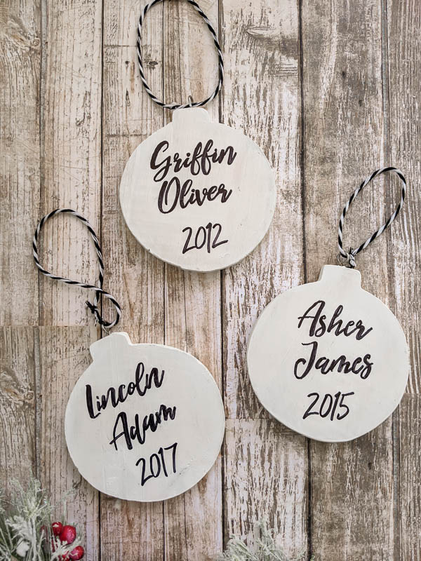 Easy, classic DIY baby's first Christmas ornaments. With a photo on one side and the name/year on the other, these diy ornaments are perfect for any style tree.
