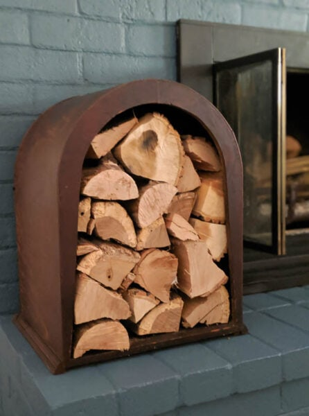 This upcycled firewood holder looks beautiful next to the fireplace. This is such a fun way to store firewood for your next fire and it was upcycled from an old vintage item nobody wanted anymore.