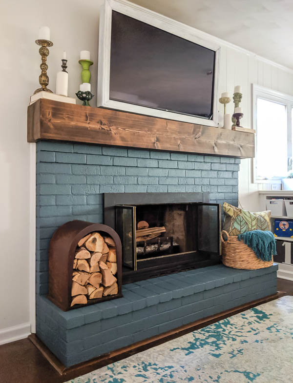 blue fireplace with rustic mantel