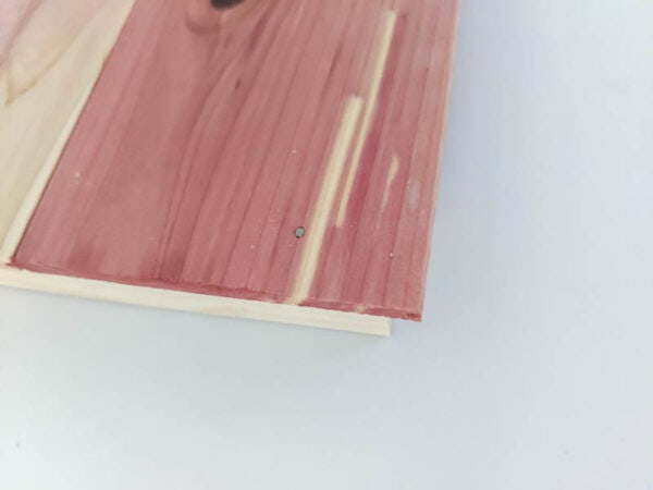 using glue and brad nails to make a wood plank storage cube