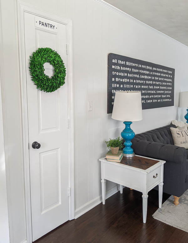 pantry door with sign and wreath