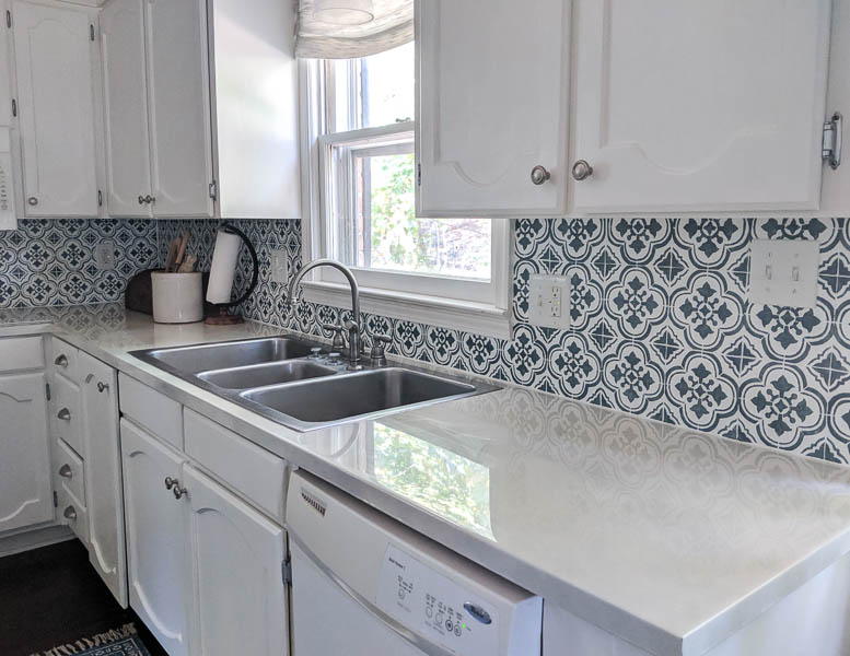 kitchen with blue and white stenciled backsplash