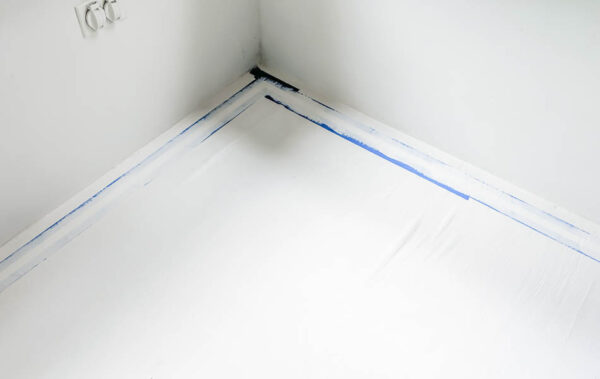 sealing the painter's tape with paint