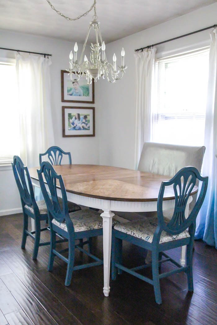 dining table with a refinished top and white legs with chairs painted blue.