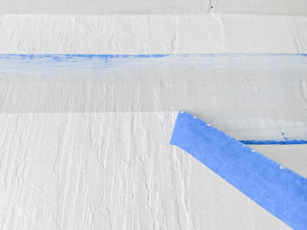 removing painter's tape for a perfect paint line