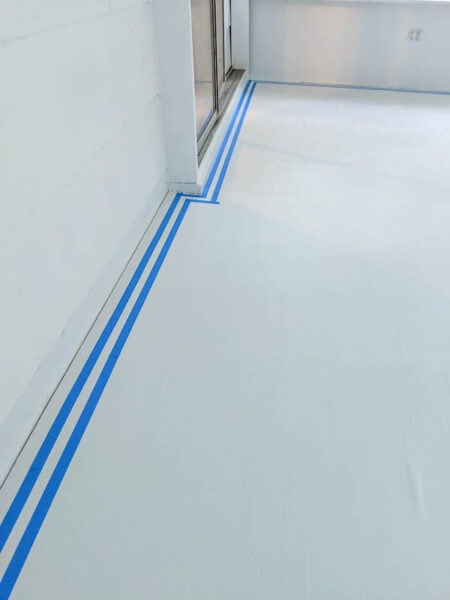 using painter's tape to create a border for painted floor