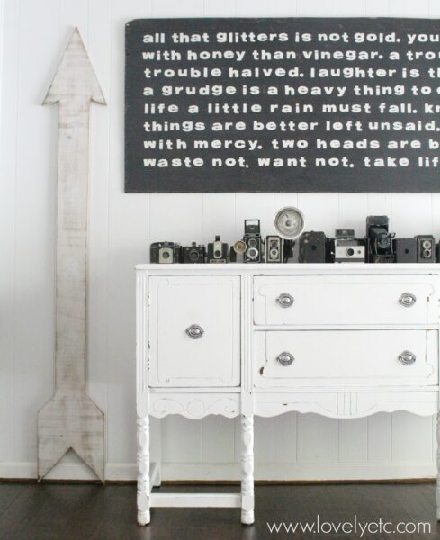 white painted buffet with vintage cameras