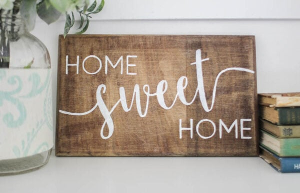 wood sign with white letters saying home sweet home
