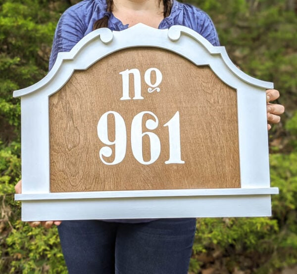 diy house number made from an old frame, plywood, and stenciled numbers