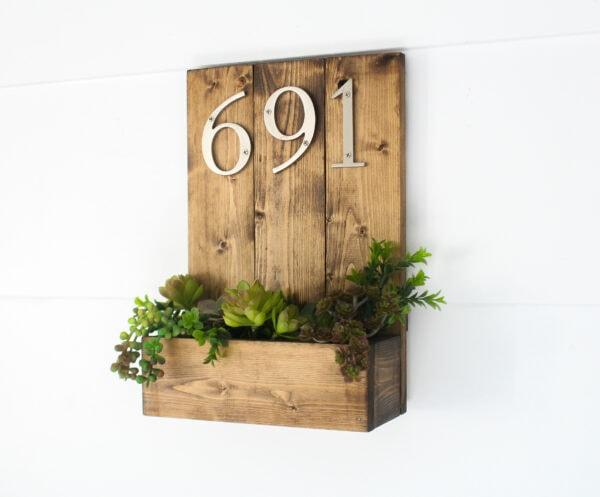 diy house number made from wood planks with a succulent planter below the numbers