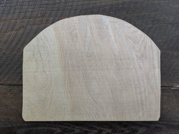 plywood cut into an arch shape to fit frame