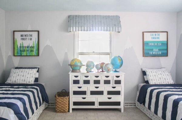 boys shared bedroom with white dresser, two twin beds, globe collection, and DIY wooden signs