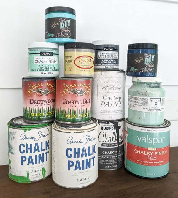 Stack of 11 different furniture paints