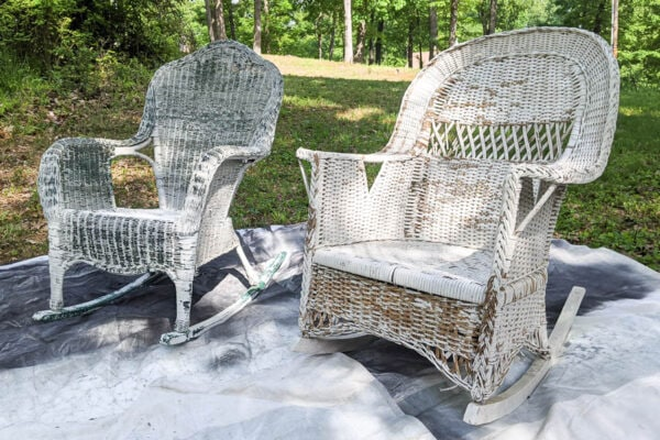 2 wicker rocking chairs once the peeling paint has been removed