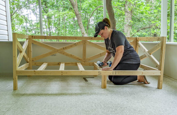 Carrie attaching slats to diy daybed.