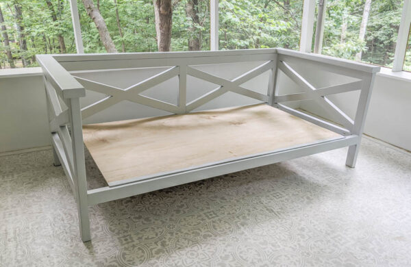 Finished diy daybed with plywood platform for mattress.
