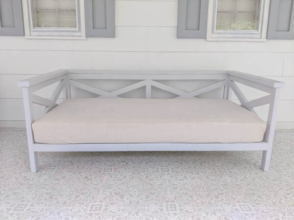 light gray daybed with twin mattress with linen cover.